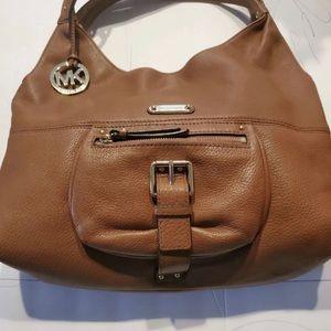 Michael kors bag like new. Only used once.